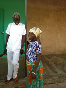 Dr. Abdulai laughs with a patient at his clinic